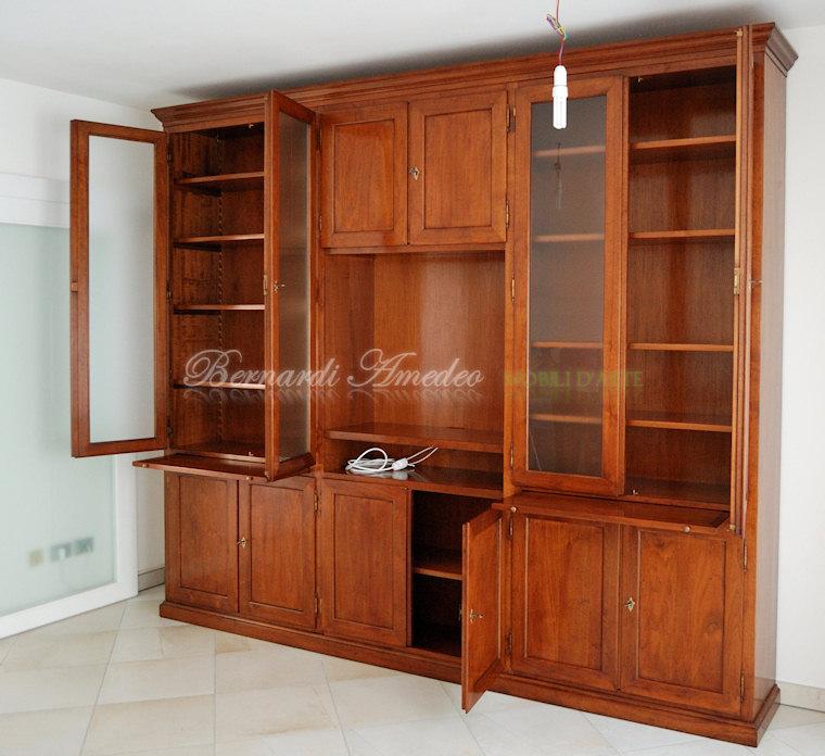 Mobili Tv Libreria : Parete libreria in noce con vano centrale porta ...