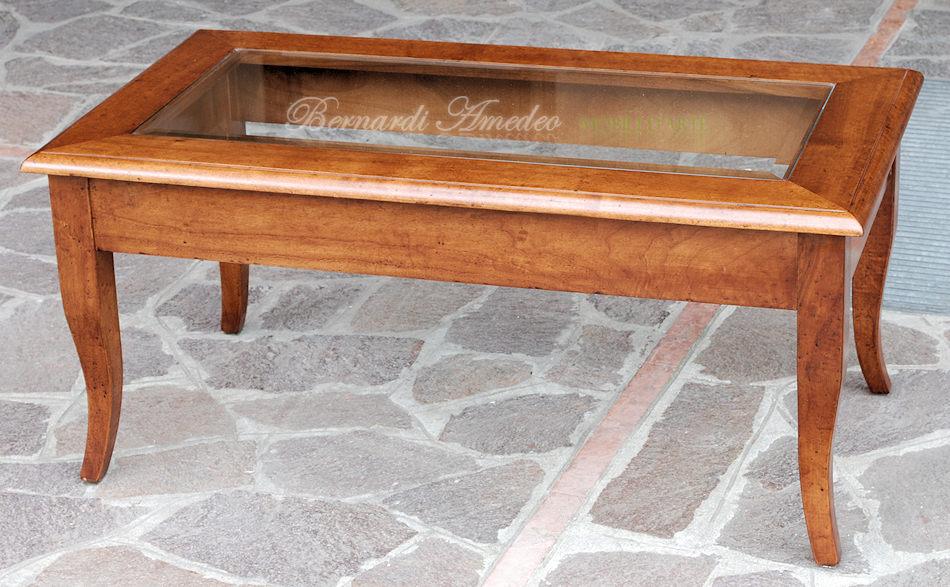 Tavolino da salotto in noce massello con vetro e gambe a sciabola